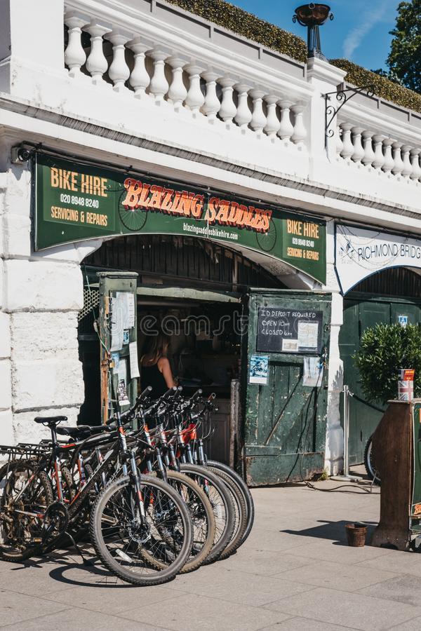 Blazing Saddles bike hire on the River Thames riverside in Richmond, London, UK. London, UK - August 1, 2018. Blazing Saddles bike hire on the River Thames royalty free stock images