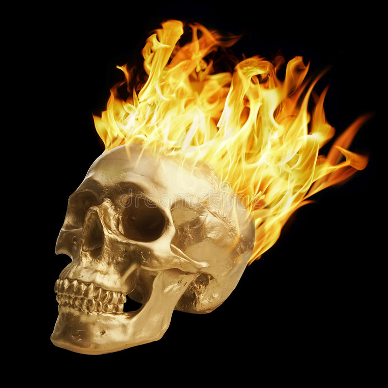 Blazing Skull. Golden skull with blazing fire stock photo