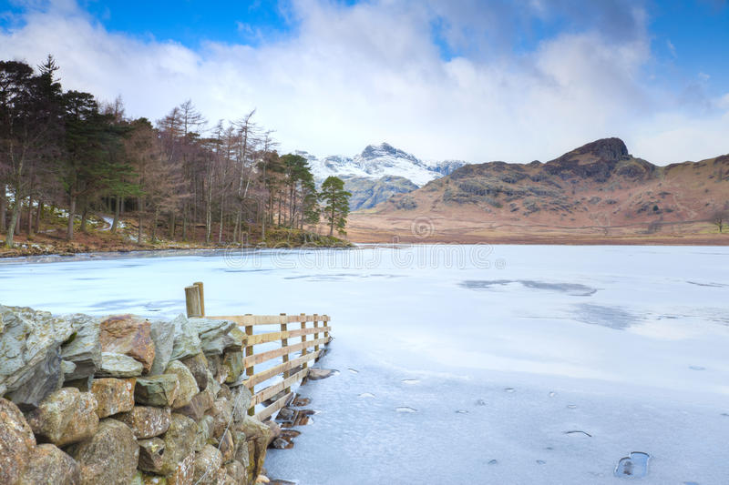 Blea Tarn. On a winters day looking towards Langdale Pikes stock photography