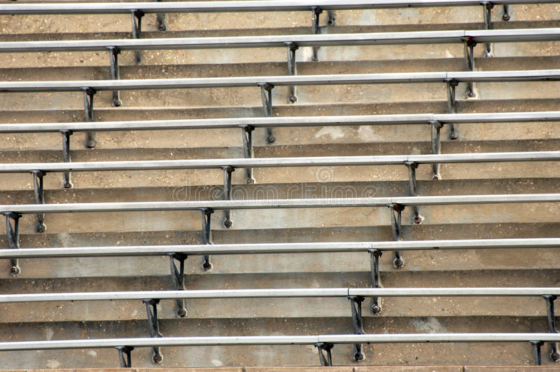 Bleachers. Background image of metal bleachers at sports arena. Seats and steps fill image royalty free stock photography