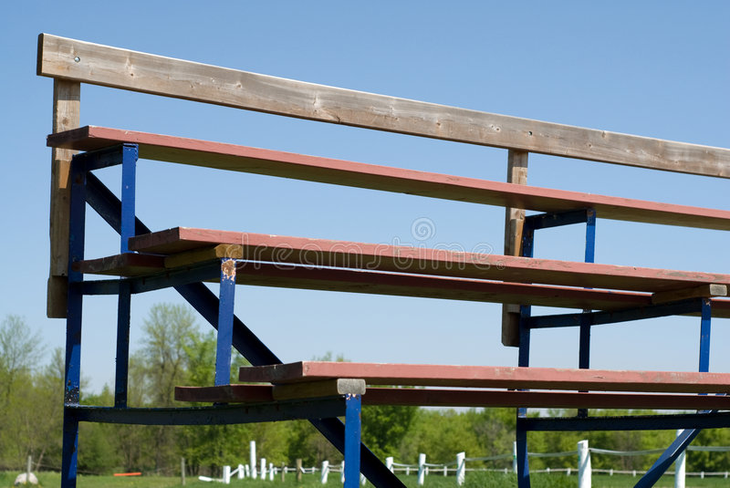 Bleachers. Low angle view of a set of school bleachers, shot against a blue sky royalty free stock photography