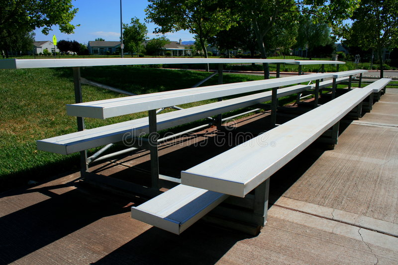 Bleachers. Empty bleachers on a stadium in a park royalty free stock photo