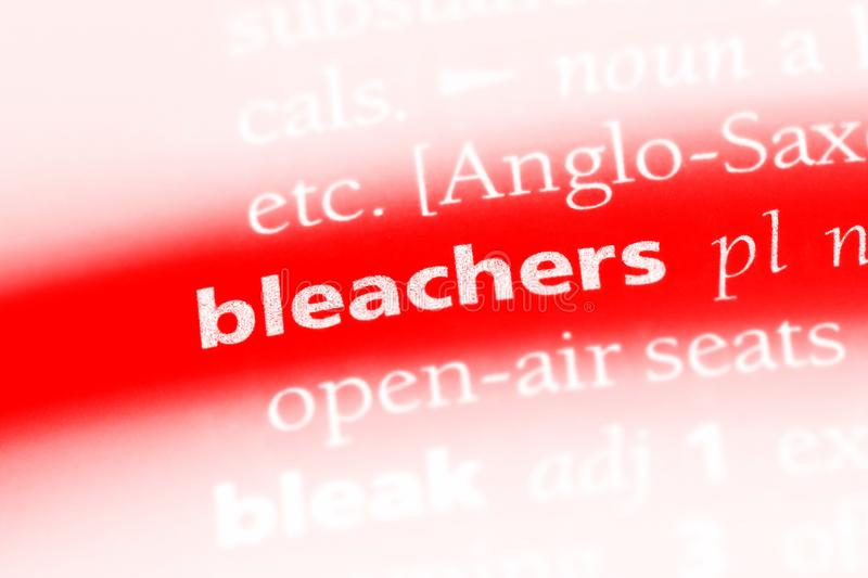 Bleachers. Word in a dictionary.  concept royalty free stock photo