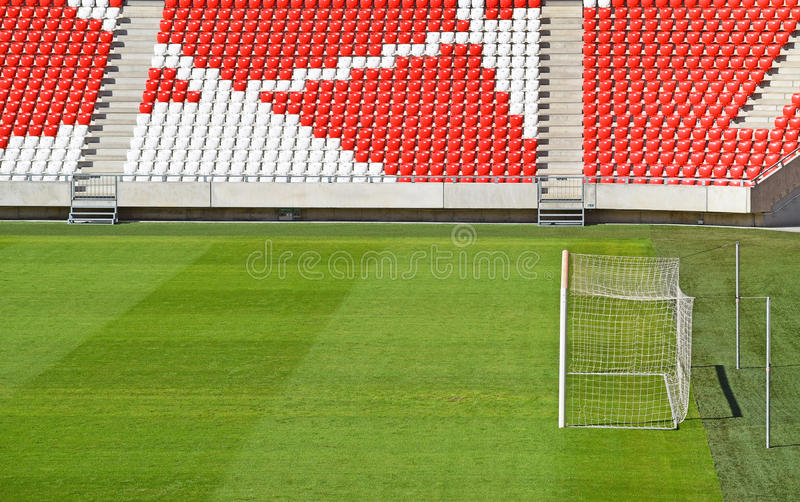 Bleachers and goal in the stadium. Empty bleachers and the goal in the stadium royalty free stock photography