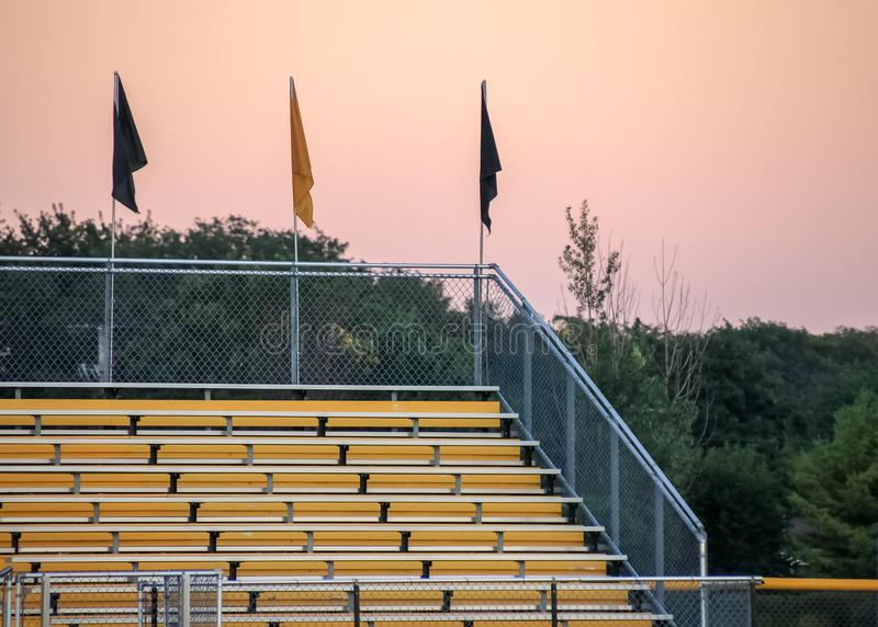 Bleachers at sports game during sunset royalty free stock photography