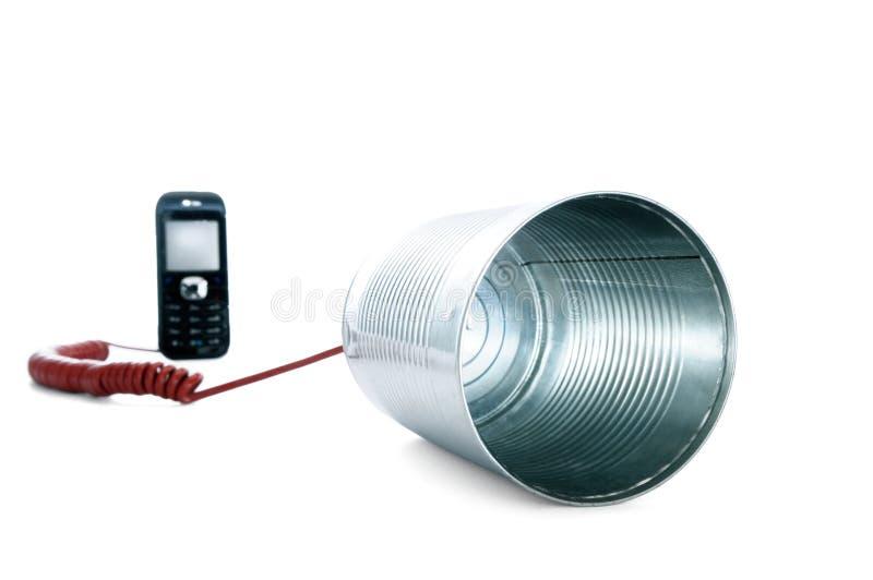 Blechdosetelefon verdrahtet zu einem Handy stockfoto
