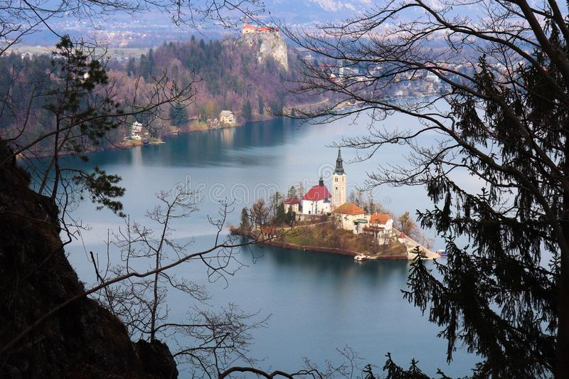 Bled island and castle. Seen from viewpoint through leafs in royalty free stock photos