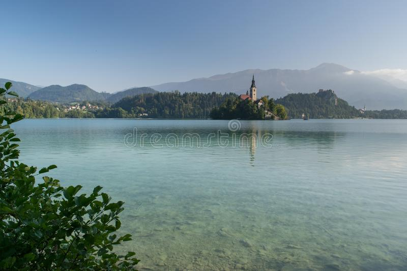 Bled with lake, island and mountains in background royalty free stock photography