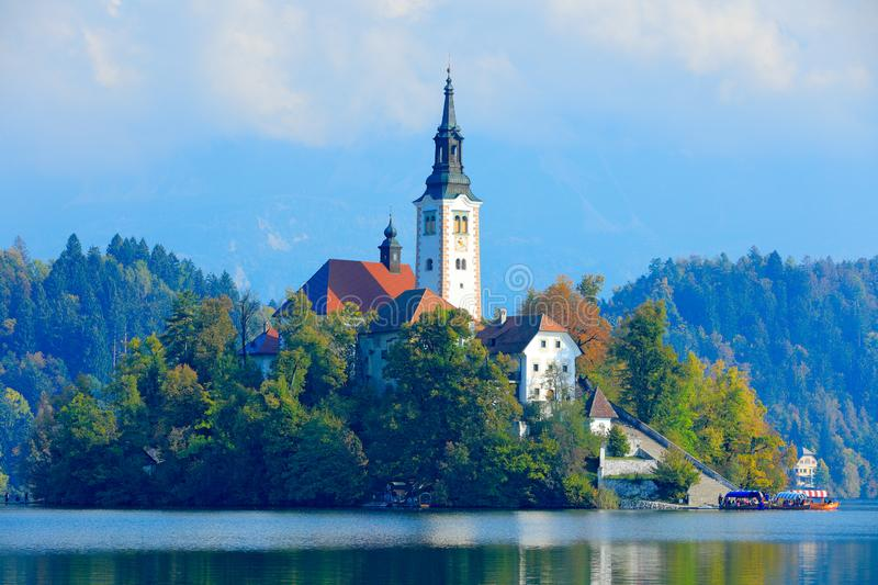 Bled lake island, St Martin Catholic church and Castle. Landscape in Slovenia, nature in Europe. Foggy Triglav Alps with forest,. Travel in Slovenia. Beautiful stock photos