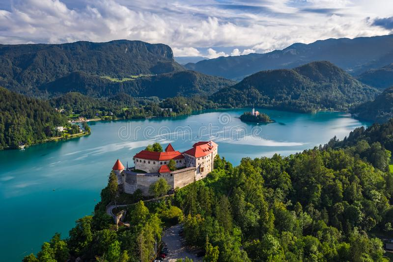 Bled, Slovenia - Aerial drone view of beautiful Bled Castle Blejski Grad with Lake Bled Blejsko Jezero. The Church of the Assumption of Maria and Julian Alps royalty free stock photography