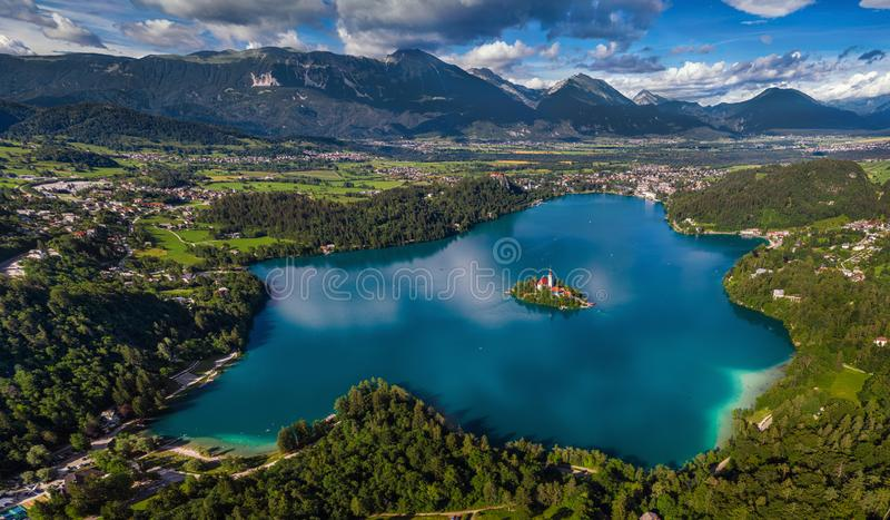 Bled, Slovenia - Aerial panoramic skyline view of Lake Bled Blejsko Jezero from high above with the Pilgrimage Church. Of the Assumption of Maria, Bled Castle royalty free stock image