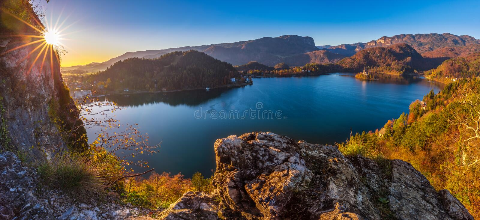 Bled, Slovenia - Beautiful autumn sunrise at Lake Bled on a panoramic shot with Pilgrimage Church of the Assumption of Maria royalty free stock images