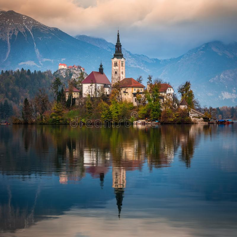 Bled, Slovenia - Beautiful autumn sunrise at Lake Bled with the famous Pilgrimage Church of the Assumption of Maria. With Bled Castle and Julian Alps at stock images
