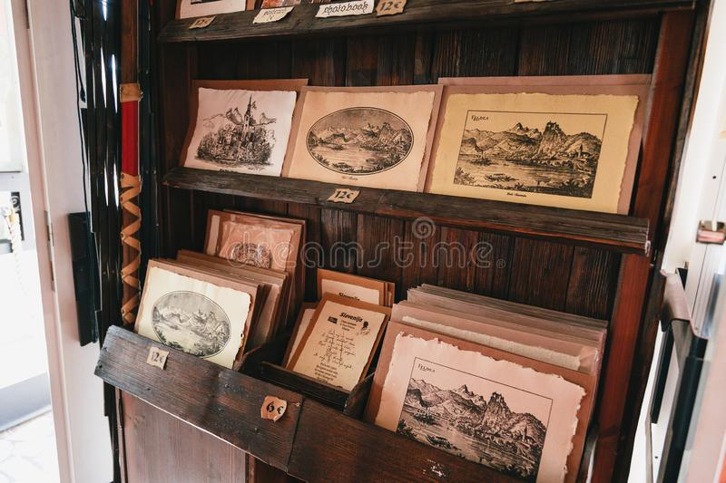 Bled, Slovenia - September, 8 2018: Close up of ancient souvenir post cards with landscapes printed on reconstructed Gutenberg`s royalty free stock photography