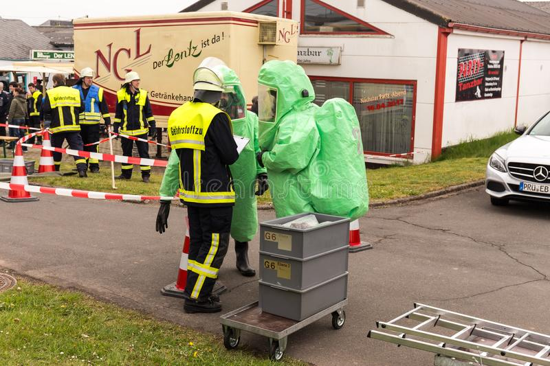 BLEIALF, GERMANY, MAY 7, 2017 - Fireman demonstrate how to handle hazardous material - public demonstration. Fireman demonstrate how to handle hazardous material royalty free stock image