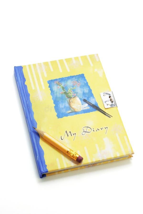 Bleistift auf Tagebuch stockbild