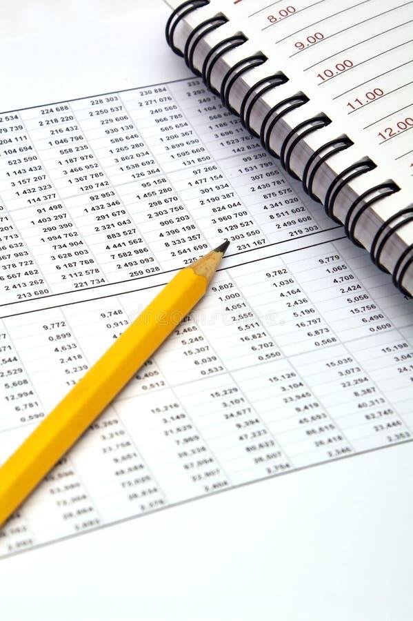 Bleistift- und Datentabellen stockbilder