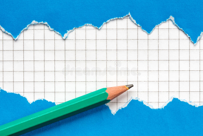 Bleistift und heftiges blaues Papier lizenzfreies stockbild
