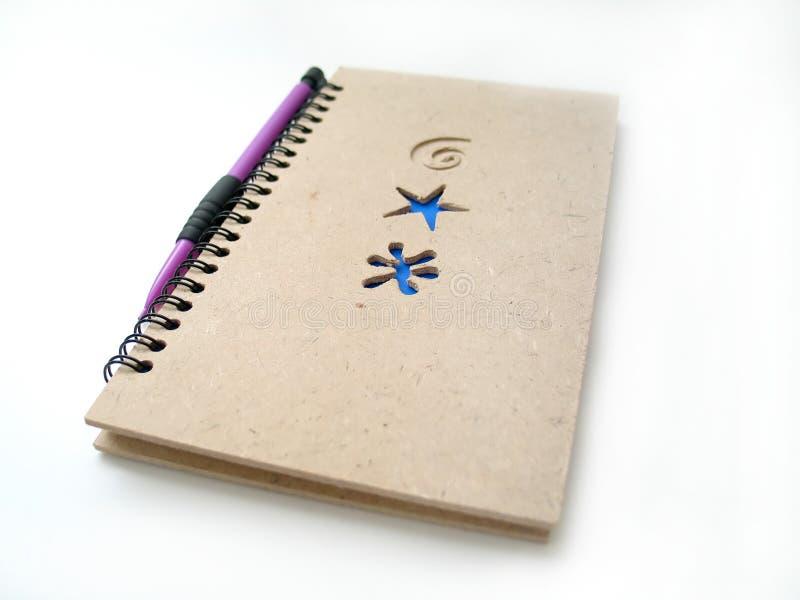 Bleistift und Journal lizenzfreies stockbild