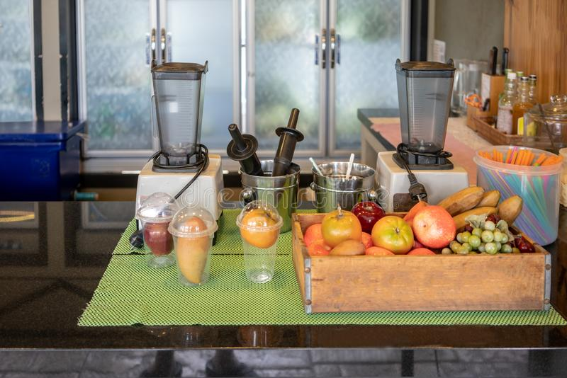 Blender machines and fruits in kitchen space in restaurant stock images