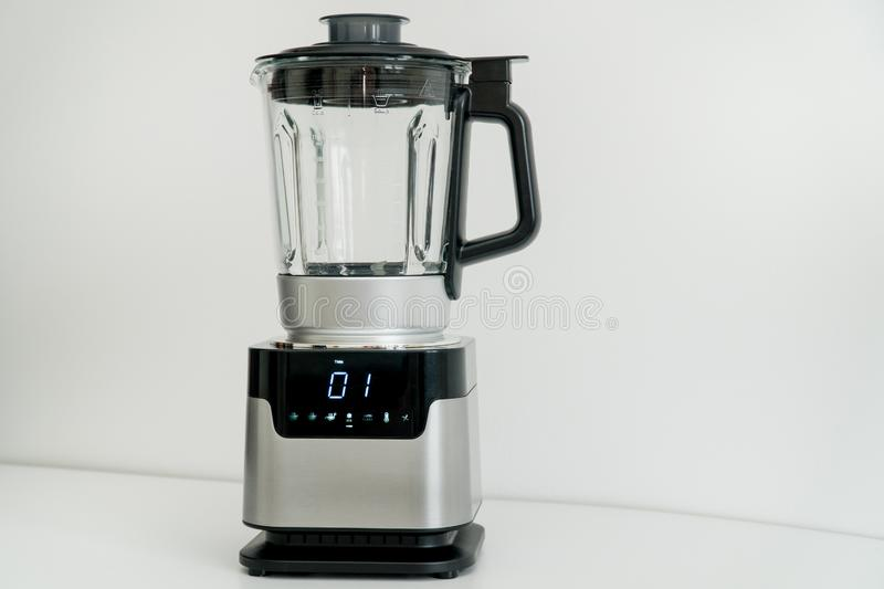 Blender with touch-screen in the kitchen. Electric Kitchen and Household Domestic Appliance. Blender in the kitchen. Electric Kitchen and Household Domestic royalty free stock photos