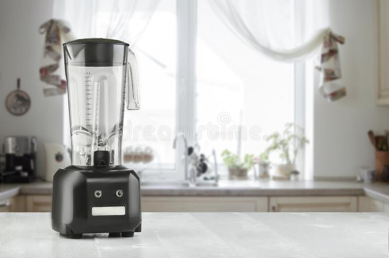 Blender and wooden table in kitchen. Do Smoothies stock photography