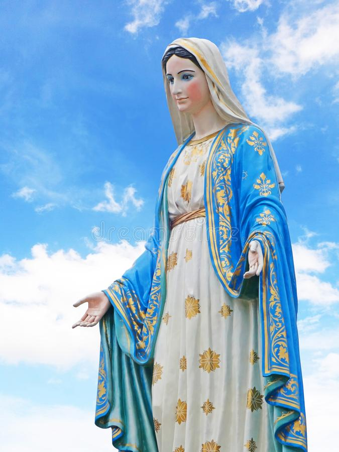 Blessed Virgin Mary statue isolated on white background stock photo