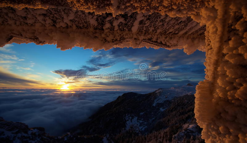Mountain landscape. Winter, icy snow, sunrise. Spectacular sunrise in mountains - Ceahlau Mountains, landmark attraction Romania. Mountain landscape. Winter, icy stock image