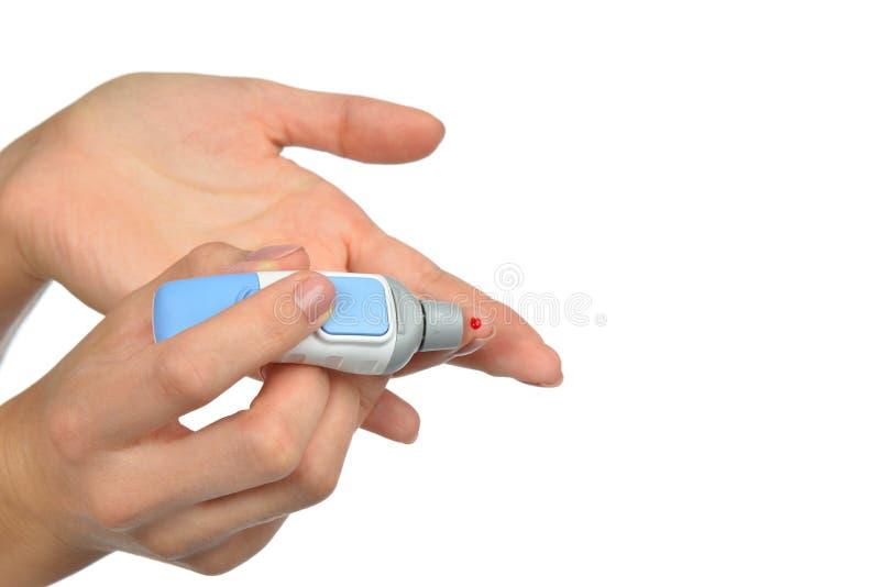 Blessure de sang du doigt patient de diabète pour faire le niveau b de glucose photographie stock