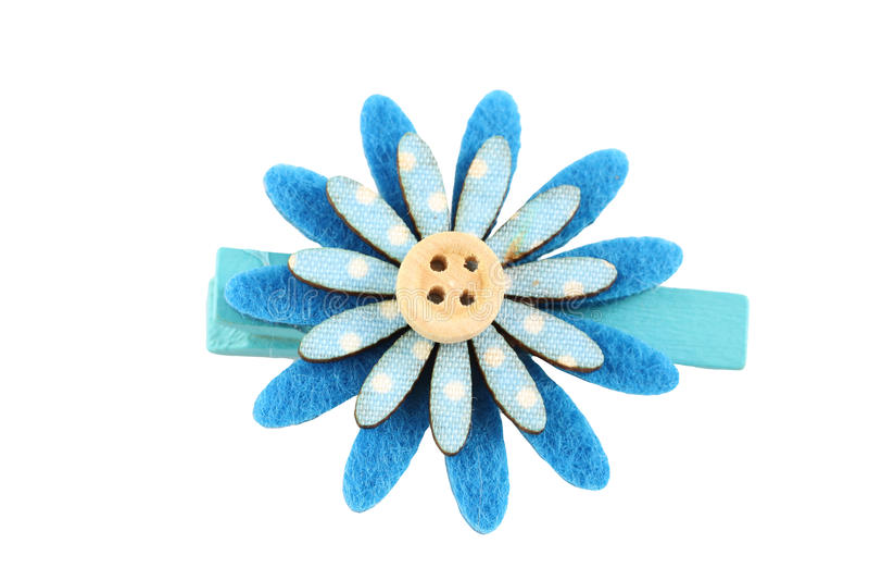 Bleu de l'épingle à cheveux de fleur artificielle d'isolement sur le blanc image stock