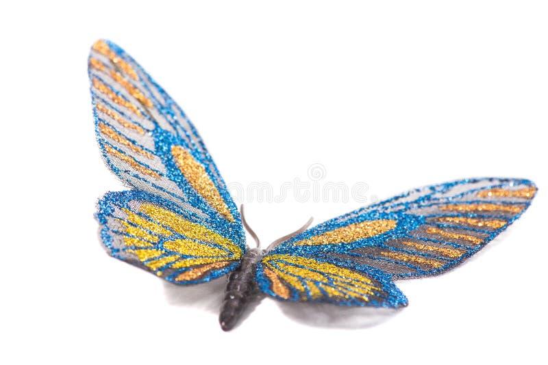 Bleu et jaune décoratifs de papillon d'isolement sur un fond blanc images libres de droits