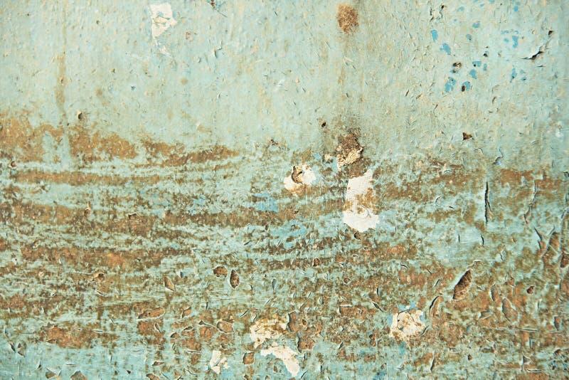 Bleus abstraits, le beige et le fond de turquoise wallpaper la texture Vieille peinture floconneuse épluchant le mur criqué sale  photographie stock libre de droits
