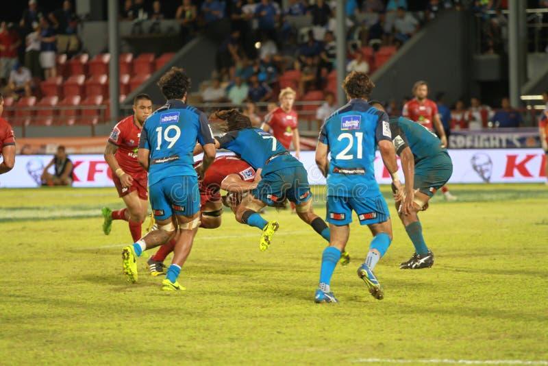 Bleus d'Auckland contre des rouges du Queensland jouant au Samoa photos libres de droits