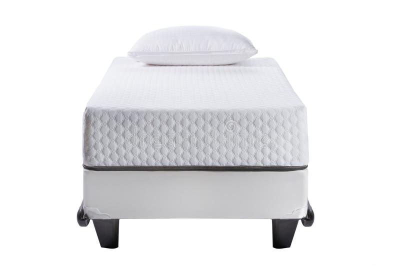 Bliźniaczego łóżka rama z miękką materac i białą poduszką odizolowywającymi na białym tle zdjęcia royalty free