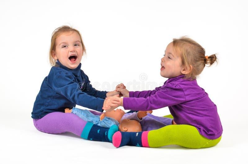Bliźniaczy dzieci ćwiczyć zdjęcia royalty free