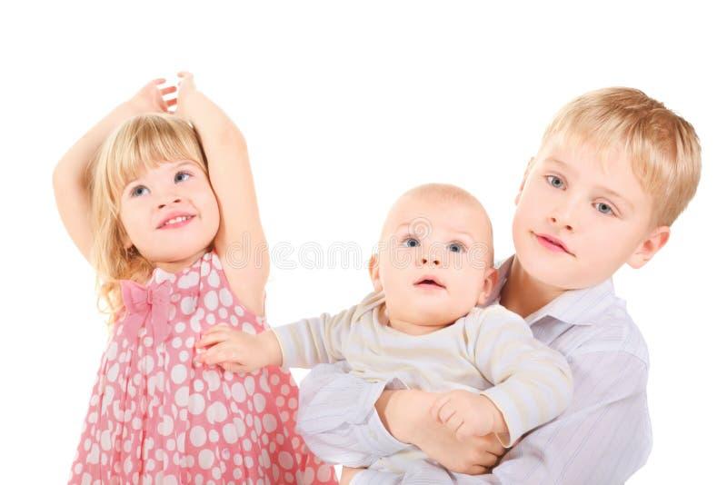 Blij meisje, weinig jongen en baby. stock afbeelding