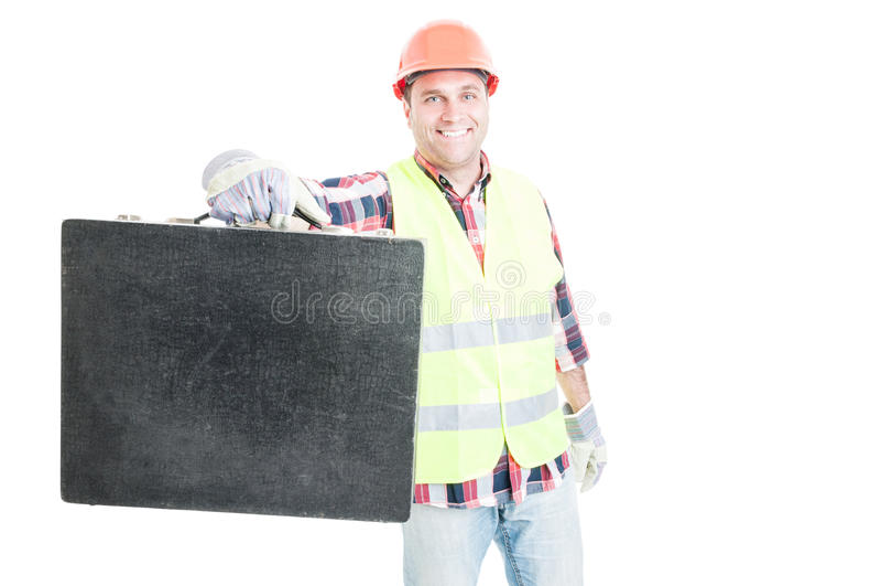 Blije jonge aannemer die zijn toolbox tonen royalty-vrije stock foto's