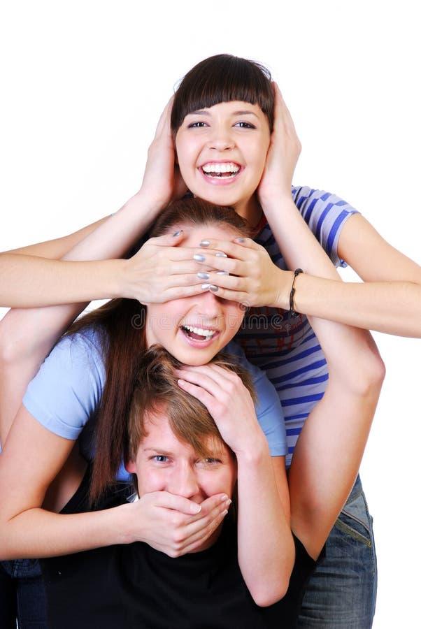 Blije tienergroep stock afbeeldingen