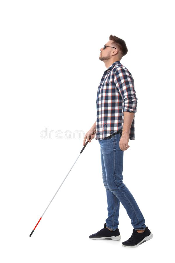 Blind  in dark glasses with walking cane on white background royalty free stock photography