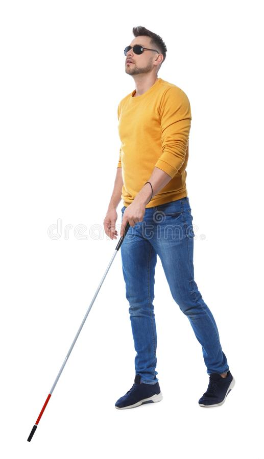 Blind man in dark  with walking cane on white background stock photo