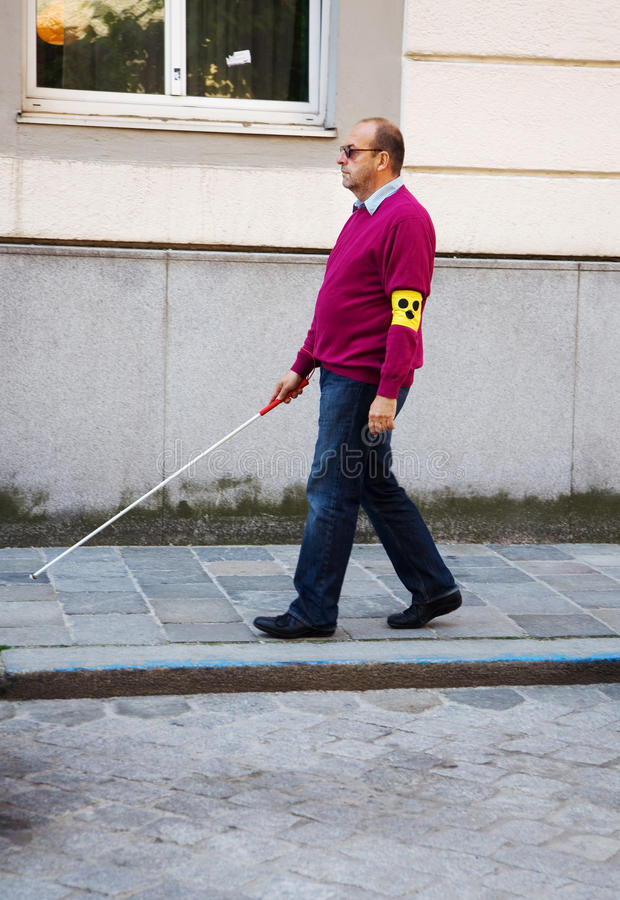 Blind man with stick royalty free stock image