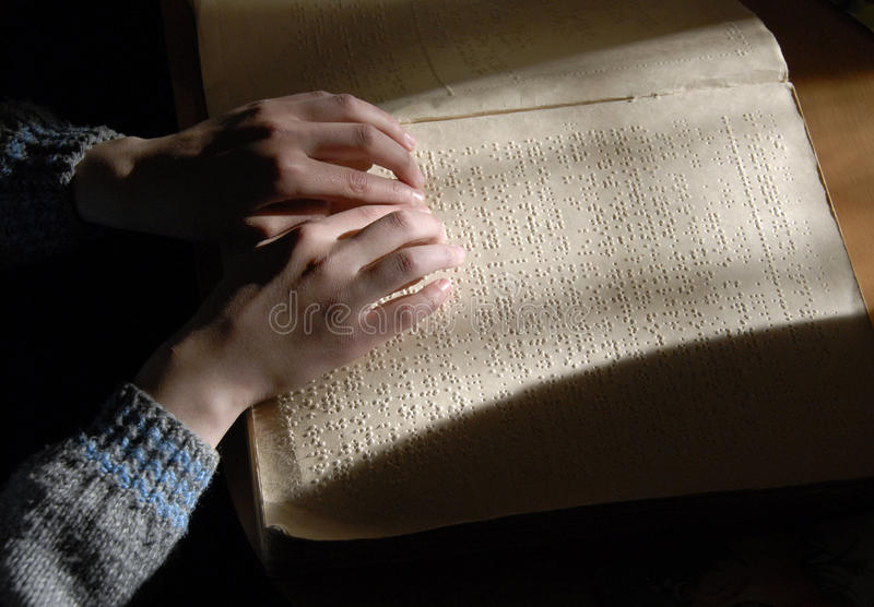Blind reading text in braille. close-up of human hands reading b. Raille royalty free stock photos