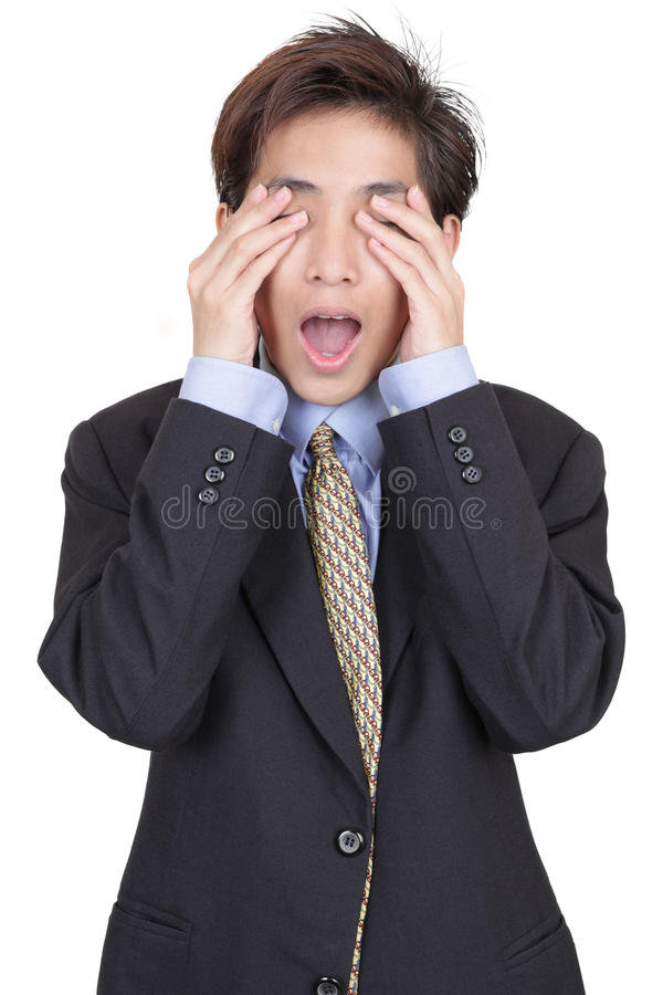 Blinded businessman in denial. Standing oriental Chinese young businessman covering his eyes in denial of reality and blinded for corporate and business royalty free stock photo