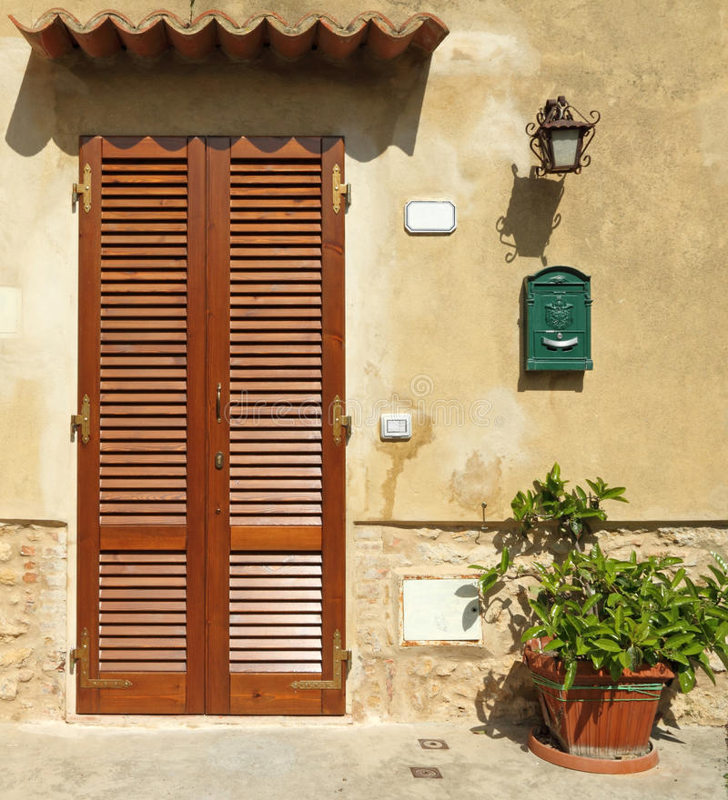 Blinded door. To the tuscan house, Italy stock photo