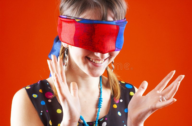 Blindfold Game - 2. Young teenager throws up her hands at a silly game of hide and seek royalty free stock image