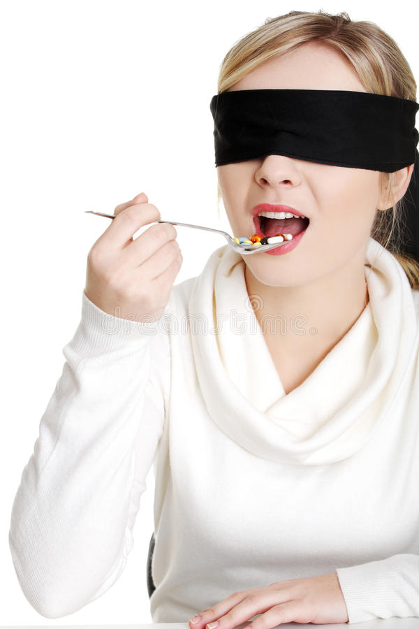 Download Blindfold Woman Holding Spoon With Pile Of Pills Stock Image - Image: 23164091