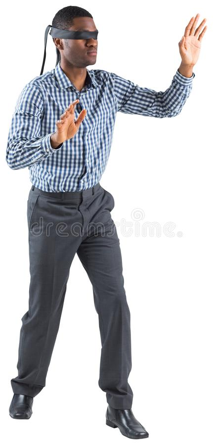 Blindfolded businessman with arms out stock photography