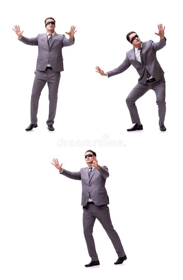 The blindfolded businessman isolated on white stock photos
