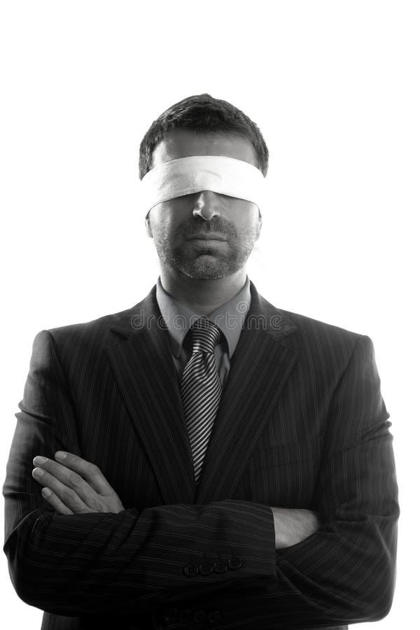 Blindfolded businessman over white background royalty free stock image