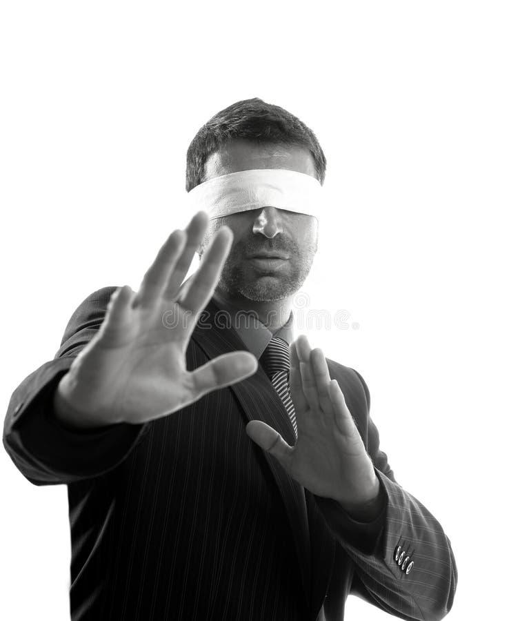Blindfolded businessman over white background stock photo